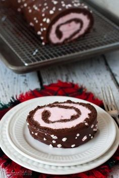 Chocolate Peppermint Ice Cream Cake Roll drenched in rich milk chocolate.