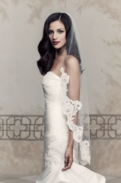 One tier Fingertip length veil with French Alençon lace edging starting at the shoulder. Style V433F  Paloma Blanca Wedding Veil