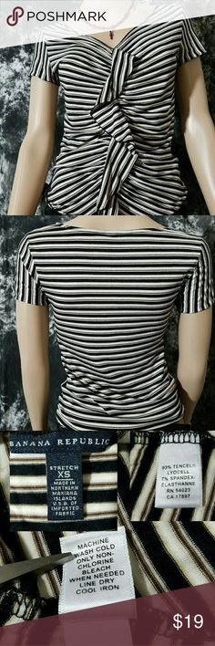 """Banana republic stripe Ruffle v neck top Pre-owned.Banana republic.Extra small (0-2) In good condition. No stains,rips or tears. Black, brown and beige stripe. V neck.ruffled top please refer to the pictures posted.Measurement: 15.5"""" armpit to armpit, 21"""" Long. Stretchable. Very comfortable and soft to touch. 93% Tencel Lyocell. 7% Spandex Elasthanne. Easy to take care.Made in Northern Mariana Islands USA of imported fabric. Sharp looking blouse. Banana Republic Tops Blouses"""