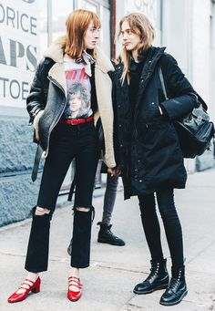Left, a graphic t-shirt is paired with a shearling moto jacket, red belt, cropped jeans, and red Mary Jane heels. Right, an all black look is paired with a backpack and combat boots