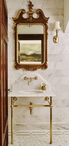 Regal bathroom design with  decorative mirror and exposed vanity   Anna Braund