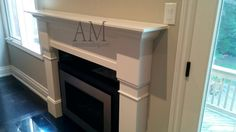 Modern Designed Fireplace Mantels Waffle Ceiling, Modern Fireplace Mantels, Family Room Fireplace, Kitchen Cabinets, Kitchen Appliances, Classic Living Room, Crown Molding, Wainscoting, Wall Units