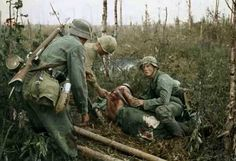 """greasegunburgers: """" The Battle of Wolchow (Volkhov) near Lake Ladoga (Leningrad) in July (Nb. Yes, we do know the Soviet soldier has his helmet on back to front) """" German Soldiers Ww2, German Army, American Soldiers, Nagasaki, Hiroshima, German Uniforms, Ww2 Photos, History Online, War Photography"""