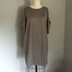 Calvin Klein Dress Calvin Klein doleman sleeve casual dress. Sleeves are half length and gathered with a self-fabric tab. Dress has two pockets. Soft fabric. Very comfortable. Made to be work loose. Calvin Klein Dresses
