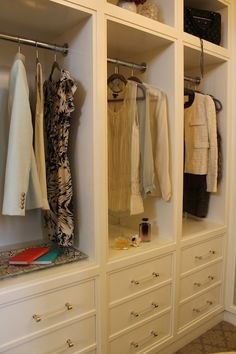 Material Girls: Paola Salinas - Amazing walk-in closet design with white built-in closet cabinets with LUCITE hardware! ♥