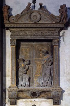 Donatello. Annunciation 1435. Gilded Pietra Serena. Santa Croce Florence.