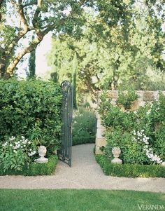 stone walls and gravel paths in the garden; dustjacket attic: Interiors | A Farmhouse In Provence
