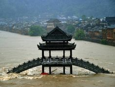 The ancient Chinese town of Fenghuang has been submerged in water after severe storms battered the region. News China, Severe Storms, Ancient China, Top Photo, Capital City, Beautiful Landscapes, Natural, Big Ben, Underwater
