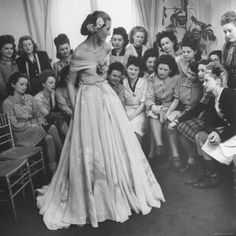 Young Woman Modeling the Lafaurie's Finished Product For the Tailors Before the Showing