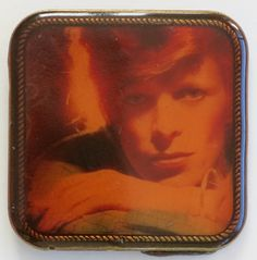 "A scarce David Bowie belt buckle issued by RCA Records in 1975 as a promotional item for his album Young Americans. The buckle measures 2 1/4"" square, and wil"
