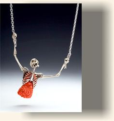 Kim Eric Lilot,Skeletal Primal Scream/Dream necklace. One of a Kind Fine Jewelry -White Gold with carved Coral Intenstines and Rubelite Tourmaline Heart. Ball and socket joinery fro the humerus and scapula connection. Stunning!