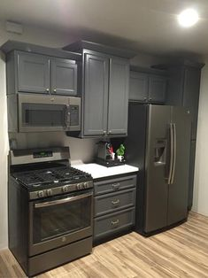 Kitchen Remodel Discover GE 30 in. Gas Range in Slate Fingerprint - The Home Depot Small Basement Kitchen, Small Kitchen Cabinets, Small Apartment Kitchen, Kitchen Redo, Kitchen Remodel, Kitchen With Black Appliances, Small Basement Apartments, One Wall Kitchen, Kitchen Room Design