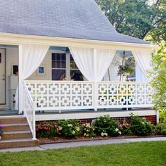 Porch curtains and interesting geometric siding give this front porch the feel of a cozy outdoor room. More ways to add curb appeal to your home: http://www.midwestliving.com/homes/decorating-ideas/curb-appeal/?page=18