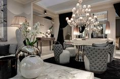 Such a glamorous dining room. Look at the extravagant tufted dining chairs.