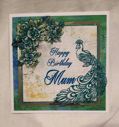 Made by Diane Greaves.  Using tattered lace peacock die and craft artist. Tonic glitter on the peacock and flower centres.