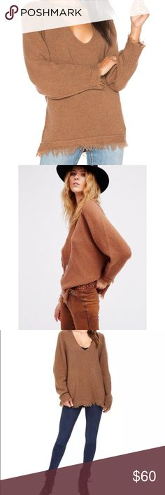 Free People Irresistible Terra-cotta Pullover S L NWT Free People Irresistible Fringe V Neck Sweater 100% Authentic Oversized wool-blend sweater gives you a cozy look  Fringe trim at cuffs and hemline. V-neckline. Long sleeve design. Straight hemline. 65% wool, 22% nylon, 11% linen, 2% spandex. Hand wash and dry flat. Imported. Measurements: Taken laying flat, approximate Length: 30 in  Armpit to Armpit 23 in. MSRP $118 Free People Sweaters
