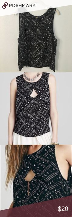 Free People top Free People brand! Cute black patterned top with a keyhole cutout in the front. Free People Tops