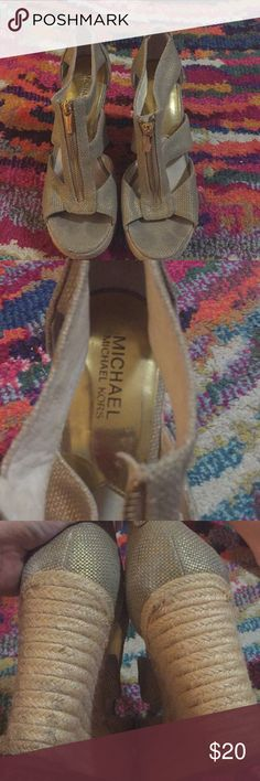 Michael by Michael Kors tan and gold wedges 9 Zip up gold and tan wedges with gold zippers size 9, with a 4 inch heel. Lined with leather. Gold has been worn off on where my feet have been. Some wear on heels and toes. See pictures. Light marking on soles from price being written on them. From a smoke and pet free home. MICHAEL Michael Kors Shoes Wedges