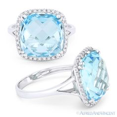 The featured ring is cast in 14k white gold and showcases a checkerboard cushion cut blue topaz center gem surrounded by round cut diamond accents all set on a splitshank-band halo setting.