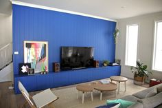 A vibrant and bold living room feature making that feature wall and TV cabinet one in the same Bold Living Room, Ceiling Panels, Tv Cabinets, Room Inspiration, Vibrant, Lounge, Interior Design, Stylish, Wall