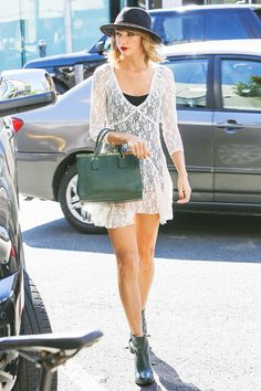 Swift reveals a little skin in the brand's signature lace dress. via @WhoWhatWear