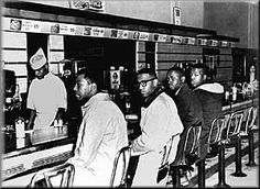 """February 1, 1960, Greensboro, North Carolina. Four students from North Carolina A sit down at a """"whites-only"""" Woolworth's lunch counter and ask to be served. This action by David Richmond, Franklin McCain, Ezell Blair, and Joseph McNeil ignites a wave of student sit-ins and protests that quickly spread across the South, with widespread """"sympathy"""" strikes in other parts of the country."""