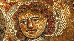 A female face depicted in mosaic on an ancient Jewish synagoge. Archaeologists uncovered this high-quality artwork in June 2012.