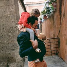 Ethan carrying Gabrielle and Abriella