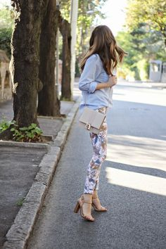 Fashion and style. Printed trousers, blue shirts, brown heels. Spring, summer fashion. Casual apparel