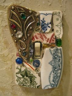 Light switchplate:  recycled broken dishes & odds and ends glued to standard switch plate.