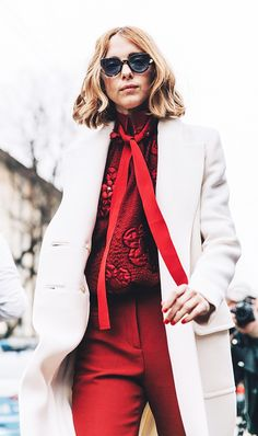 The Empowering Color That's All Over the Street Style Scene via @WhoWhatWearUK No colour is more provocative, empowering and suggestive of naughtiness. There's a red for everyone, either orange red, watermelon red or tomato red, all depends on skin tone Note - no lipstick matching, dodgy territory. #red #lipstick #colour #style