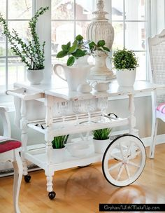 This brilliant Tea Cart Makeover is from Orphans with Makeup! It's got a new look and a new function as a houseplant stand. White pots on white cart with crystal and greenery. So beautiful.