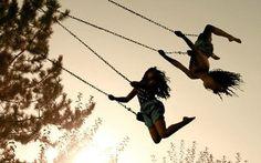 Swinging on a swing set brings me joy!