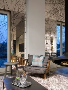 "Love the tree branches on mirrors. ""Army Barracks Become a Loft Full of Perfection"""