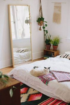 a boho bedroom with the mattress on the floor. More