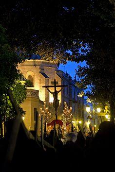 Semana Santa de Sevilla, Andalucia, Spain. Cristo de las Almas atravesando la plaza de San Pedro en el atardecer del Martes Santo