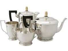Sterling Silver Four Piece Tea and Coffee Service - Art Deco Style - Antique George V  SKU: A5154 Price: GBP £1,795.00  http://www.acsilver.co.uk/shop/pc/Sterling-Silver-Four-Piece-Tea-and-Coffee-Service-Art-Deco-Style-Antique-George-V-67p8632.htm