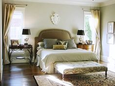 pretty bedroom, love the mix matching of furniture and patterns.