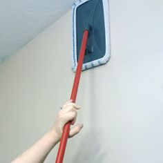 Wash the dust and dirt off your high walls with some all-purpose cleaner and a flat-head mop.   31 Clever Ways To Clean All Of The Stubbornly Dirty Things