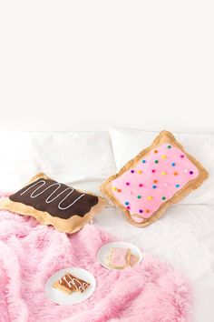 I've been crazy about making my own pop tarts lately, if you've never made them, homemade pop tarts are SO good. And when I was brainstorming new pillow/home decor projects to do, I though why not mak