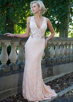 Sexy strapless Jovani lace gown with a plunging neckline features a nude underlay.