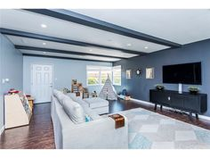 Rich, engineered espresso wood flooring throughout flows seamlessly through the spacious and bright living room with brand new fireplace.