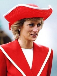 Princess Diana wearing a red Catherine Walker suit and Philip Somerville hat while attending a passing out parade at Dartmouth Royal Naval College in Devon, April 1989.