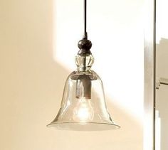 this is a pottery barn light...Rustic Glass Pendant $198.  Love the look for the kitchen