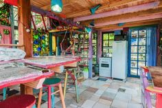 Incredible Recycled and Colorful Home Built From Salvaged Materials in Uruguay. This tiny house includes hundreds of used bottles, and is now available to rent.   Tiny Homes