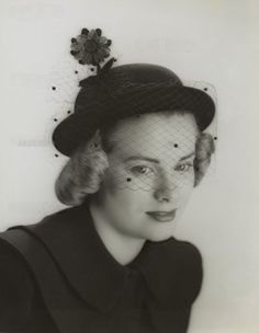 Grace Kelly modeling a veiled hat at age 20 in 1949. She was studying at the American Academy of Dramatic Arts in New York.
