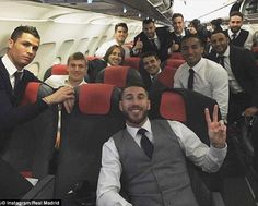 Cristiano Ronaldo (left) and Sergio Ramos (front right) pose with the Real Madrid squad on the flight home