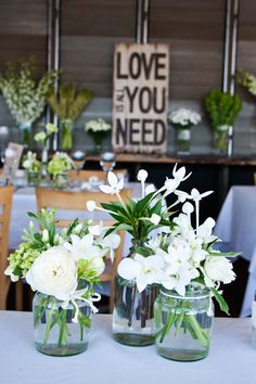 """Love is all you Need"" Wedding Reception Flowers 