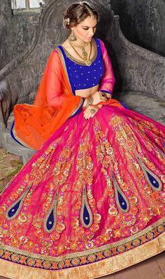 Add grace and charm to your appearance in this pink color net embroidered lehenga cholie. The ethnic stones, lace and resham work within the lehenga adds a sign of splendor statement with your look. #flaredlehengacholi #traditionallehangacholie  #gorgeousembroideredlehangacholis
