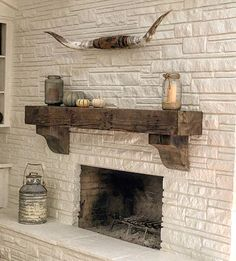 """""""This reclaimed wood beam made for a nice mantle in this beautiful ventura home. We made the corbels and blended in the raw edges to match. #805wood…"""""""